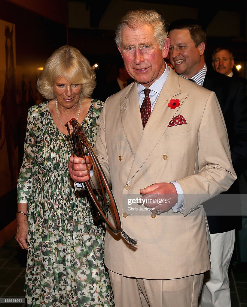 Prince Charles, Prince of Wales and <a gi-track='captionPersonalityLinkClicked' href=/galleries/search?phrase=Camilla+-+Duquesa+da+Cornualha&family=editorial&specificpeople=158157 ng-click='$event.stopPropagation()'>Camilla</a>, Duchess of Cornwall are presented with a cattle whip as they visit the Cattle Rancher's Hall of Fame on November 5, 2012 in Longreach, Australia. The Royal couple are in Australia on the second leg of a Diamond Jubilee Tour taking in Papua New Guinea, Australia and New Zealand.