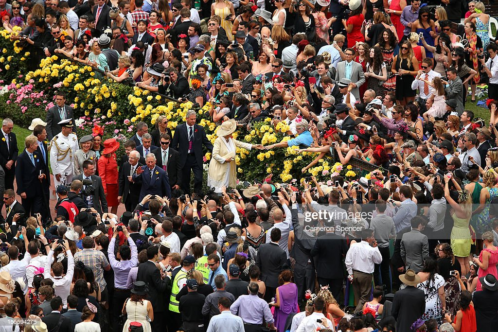 Prince Charles, Prince of Wales and Camilla, Duchess of Cornwall are greeted by thousands of racegoers on Melbourne Cup Day at Flemington Racecourse on November 6, 2012 in Melbourne, Australia.