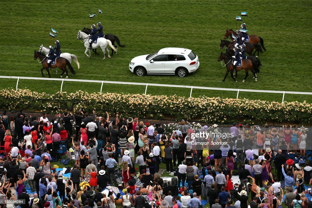 Prince Charles, Prince of Wales and Camilla, Duchess of Cornwall are driven past thousands of racegoers, escorted by Victorian Mounted Police on Melbourne Cup Day at Flemington Racecourse on November 6, 2012 in Melbourne, Australia.
