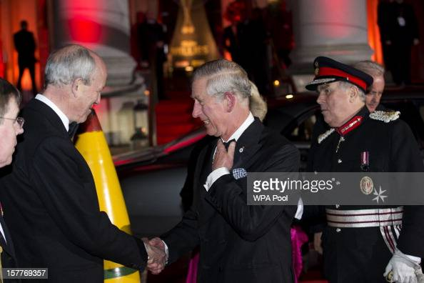 Prince Charles Prince of Wales and Camilla Duchess of Cornwall are greeted by Sir Francis Richards Chairman of the Imperial War Museum as they arrive...