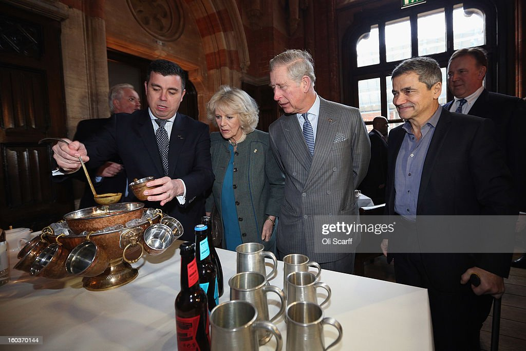 Prince Charles, Prince of Wales (centre R) and Camilla, Duchess of Cornwall are served punch made from a Victorian recipe by General Manager Kevin Kelly (L) alongside hotel co-owner Harry Handelsman (R) during a visit to the recently regenerated St Pancras Renaissance London Hotel adjacent to St Pancras International Station on January 30, 2013 in London, England. The Prince of Wales and The Duchess of Cornwall are marking the 150th anniversary of London Underground to emphasise the importance of engineering and infrastructure development in the UK.