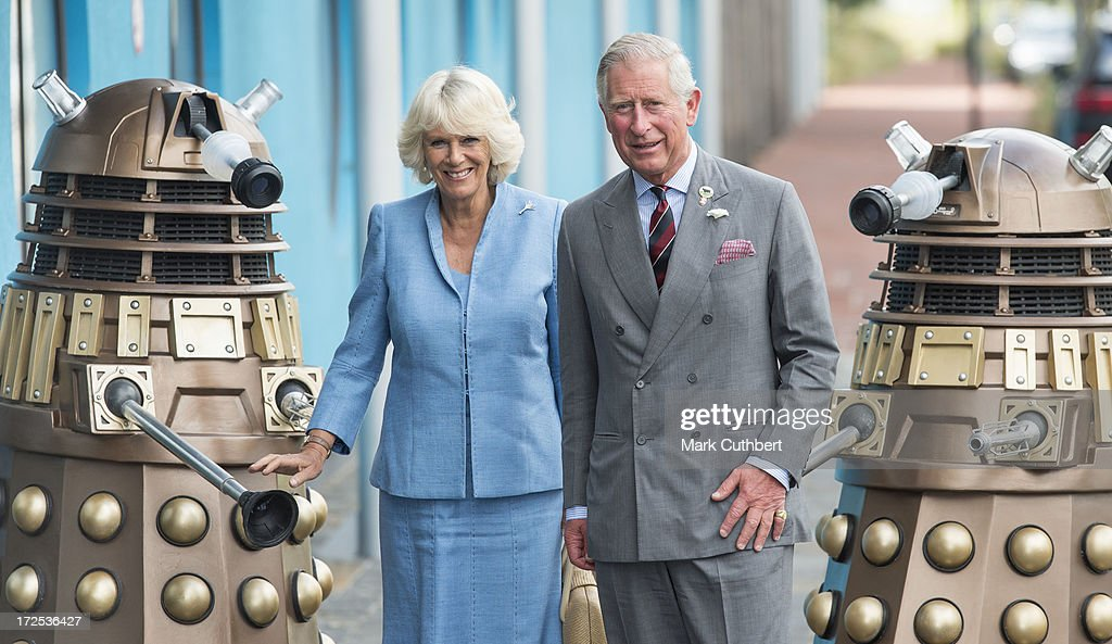 <a gi-track='captionPersonalityLinkClicked' href=/galleries/search?phrase=Prince+Charles&family=editorial&specificpeople=160180 ng-click='$event.stopPropagation()'>Prince Charles</a>, Prince of Wales and <a gi-track='captionPersonalityLinkClicked' href=/galleries/search?phrase=Camilla+-+Duchess+of+Cornwall&family=editorial&specificpeople=158157 ng-click='$event.stopPropagation()'>Camilla</a>, Duchess of Cornwall are greeted by two Daleks from the Dr Who TV series as they visit BBC Roath Lock Studios on July 3, 2013 in Cardiff, Wales.