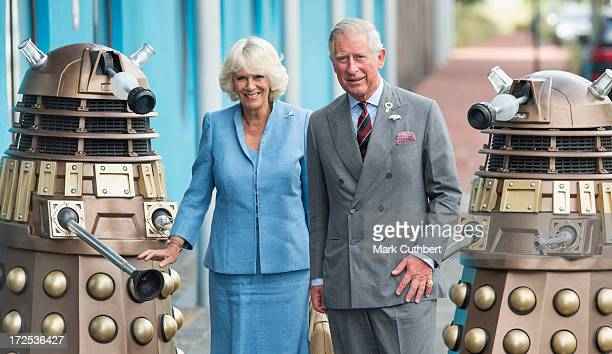 Prince Charles Prince of Wales and Camilla Duchess of Cornwall are greeted by two Daleks from the Dr Who TV series as they visit BBC Roath Lock...
