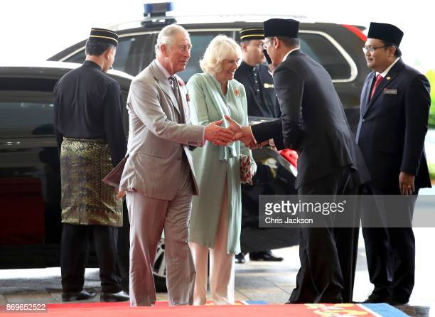 Prince Charles Prince of Wales and Camilla Duchess of Cornwall are greeted as they arrive for Tea with His Majesty The Yang diPertuan Agong XV Sultan...