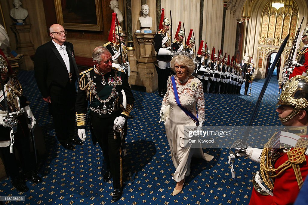 Prince Charles, Prince of Wales and <a gi-track='captionPersonalityLinkClicked' href=/galleries/search?phrase=Camilla+-+Duquesa+da+Cornualha&family=editorial&specificpeople=158157 ng-click='$event.stopPropagation()'>Camilla</a>, Duchess of Cornwall arrive through the Norman Porch of the Palace of Westminster ahead of the State Opening of Parliament on May 8, 2013 in London, England. Queen Elizabeth II unveiled the coalition government's legislative programme in a speech delivered to Members of Parliament and Peers in The House of Lords. Proposed legislation is expected to be introduced on toughening immigration regulations, capping social care costs in England and setting a single state pension rate of 144 GBP per week.