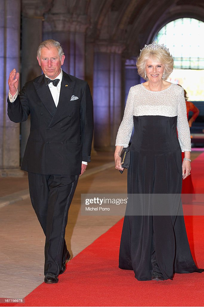 <a gi-track='captionPersonalityLinkClicked' href=/galleries/search?phrase=Prince+Charles+-+Prince+of+Wales&family=editorial&specificpeople=160180 ng-click='$event.stopPropagation()'>Prince Charles</a>, Prince of Wales and <a gi-track='captionPersonalityLinkClicked' href=/galleries/search?phrase=Camilla+-+Duchess+of+Cornwall&family=editorial&specificpeople=158157 ng-click='$event.stopPropagation()'>Camilla</a>, Duchess of Cornwall attend a dinner hosted by Queen Beatrix of The Netherlands ahead of her abdication at Rijksmuseum on April 29, 2013 in Amsterdam, Netherlands.