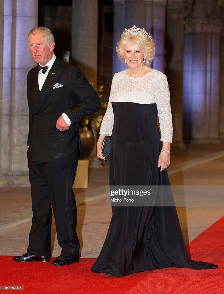 <a gi-track='captionPersonalityLinkClicked' href=/galleries/search?phrase=Prince+Charles&family=editorial&specificpeople=160180 ng-click='$event.stopPropagation()'>Prince Charles</a>, Prince of Wales and <a gi-track='captionPersonalityLinkClicked' href=/galleries/search?phrase=Camilla+-+Duchess+of+Cornwall&family=editorial&specificpeople=158157 ng-click='$event.stopPropagation()'>Camilla</a>, Duchess of Cornwall attend a dinner hosted by Queen Beatrix of The Netherlands ahead of her abdication at Rijksmuseum on April 29, 2013 in Amsterdam, Netherlands.