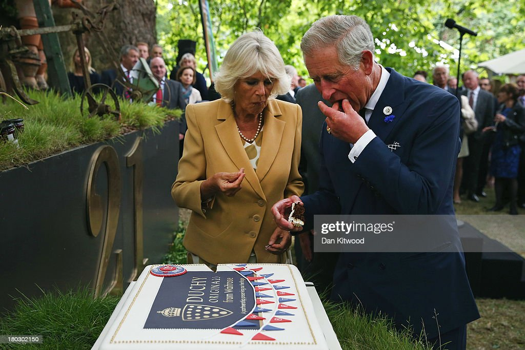 Prince Charles, Prince of Wales and Camilla, Duchess of Cornwall cut a cake to celebrate the 21st anniversary of Duchy originals products at Clarence House on September 11, 2013 in London, England. The reception was held in the gardens of Clarence House, and attended by Duchy suppliers, Waitrose and other international stockists, customers, charitable beneficiaries and representatives of some of the charities who benefit from the sale of the products.