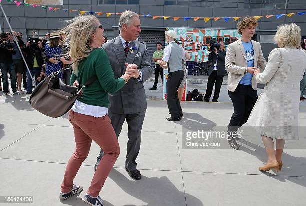 Prince Charles Prince of Wales and Camilla Duchess of Cornwall dance at the DanceOMat during a visit to Christchurch on November 16 2012 in...