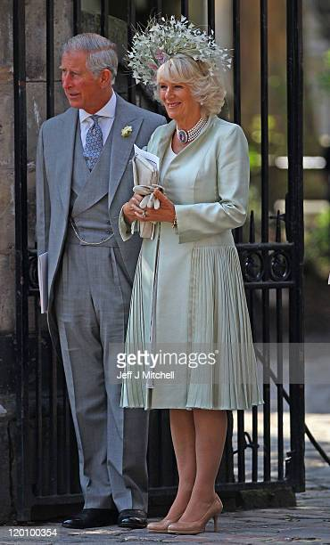 Prince Charles Prince of Wales and Camilla Duchess of Cornwall depart from the Royal wedding of Zara Phillips and Mike Tindall at Canongate Kirk on...