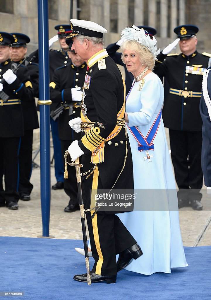 Prince Charles, Prince of Wales and <a gi-track='captionPersonalityLinkClicked' href=/galleries/search?phrase=Camilla+-+Hertiginna+av+Cornwall&family=editorial&specificpeople=158157 ng-click='$event.stopPropagation()'>Camilla</a>, Duchess of Cornwall depart the Nieuwe Kerk to return to the Royal Palace after the abdication of Queen Beatrix of the Netherlands and the Inauguration of King Willem Alexander of the Netherlands on April 30, 2013 in Amsterdam, Netherlands.