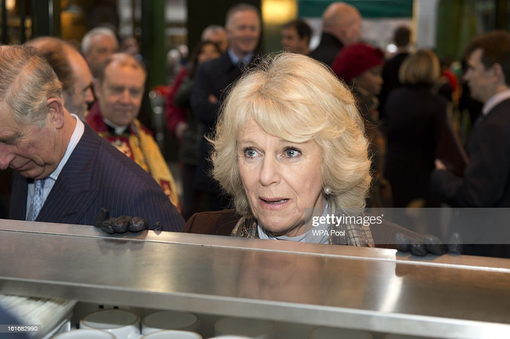 Prince Charles, Prince of Wales and Camilla, Duchess of Cornwall enjoy a cup of tea during a visit to Borough Market on February 13, 2013 in London, England.