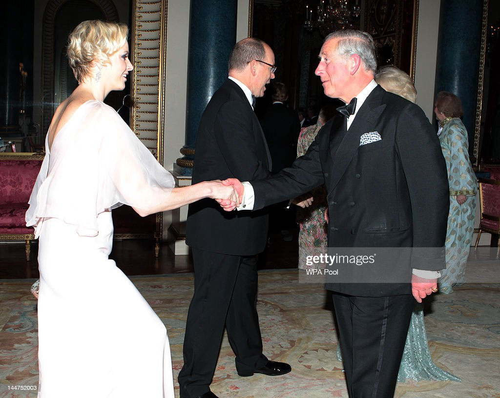 <a gi-track='captionPersonalityLinkClicked' href=/galleries/search?phrase=Prince+Charles+-+Prince+of+Wales&family=editorial&specificpeople=160180 ng-click='$event.stopPropagation()'>Prince Charles</a>, Prince of Wales and <a gi-track='captionPersonalityLinkClicked' href=/galleries/search?phrase=Camilla+-+Duchess+of+Cornwall&family=editorial&specificpeople=158157 ng-click='$event.stopPropagation()'>Camilla</a>, Duchess of Cornwall greet <a gi-track='captionPersonalityLinkClicked' href=/galleries/search?phrase=Prince+Albert+II+of+Monaco&family=editorial&specificpeople=201707 ng-click='$event.stopPropagation()'>Prince Albert II of Monaco</a> and Princess <a gi-track='captionPersonalityLinkClicked' href=/galleries/search?phrase=Charlene+-+Princess+of+Monaco&family=editorial&specificpeople=726115 ng-click='$event.stopPropagation()'>Charlene</a> of Monaco as they arrive for a dinner for foreign Sovereigns to commemorate the Diamond Jubilee at Buckingham Palace on May 18, 2012 in London, England. <a gi-track='captionPersonalityLinkClicked' href=/galleries/search?phrase=Prince+Charles+-+Prince+of+Wales&family=editorial&specificpeople=160180 ng-click='$event.stopPropagation()'>Prince Charles</a>, Prince of Wales and <a gi-track='captionPersonalityLinkClicked' href=/galleries/search?phrase=Camilla+-+Duchess+of+Cornwall&family=editorial&specificpeople=158157 ng-click='$event.stopPropagation()'>Camilla</a>, Duchess of Cornwall hosted the event.