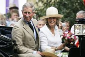 Prince Charles Prince of Wales and Camilla Duchess of Cornwall in an open carriage at the Sandringham Flower Show on July 26 2006 in Norfolk England