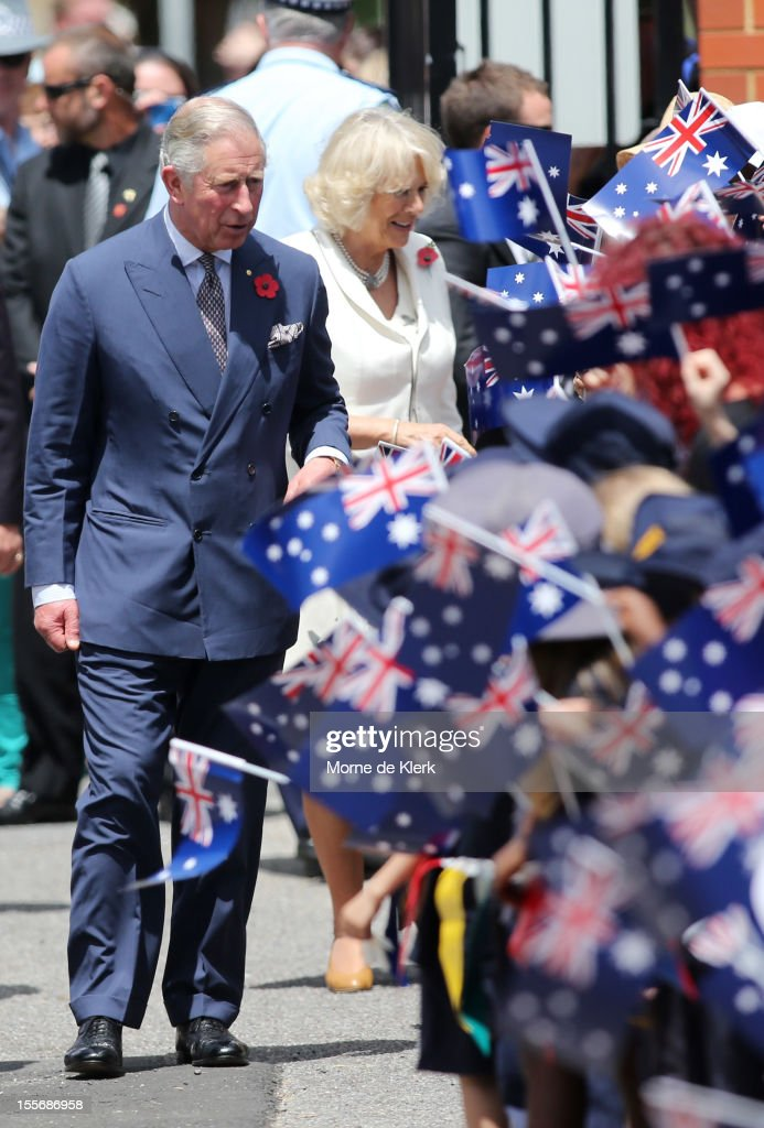<a gi-track='captionPersonalityLinkClicked' href=/galleries/search?phrase=Prince+Charles&family=editorial&specificpeople=160180 ng-click='$event.stopPropagation()'>Prince Charles</a>, Prince of Wales and <a gi-track='captionPersonalityLinkClicked' href=/galleries/search?phrase=Camilla+-+Duchess+of+Cornwall&family=editorial&specificpeople=158157 ng-click='$event.stopPropagation()'>Camilla</a>, Duchess of Cornwall is greeted by school children during a visit to Kilkenny Primary School on November 7, 2012 in Adelaide, Australia. The Royal couple are in Australia on the second leg of a Diamond Jubilee Tour taking in Papua New Guinea, Australia and New Zealand.