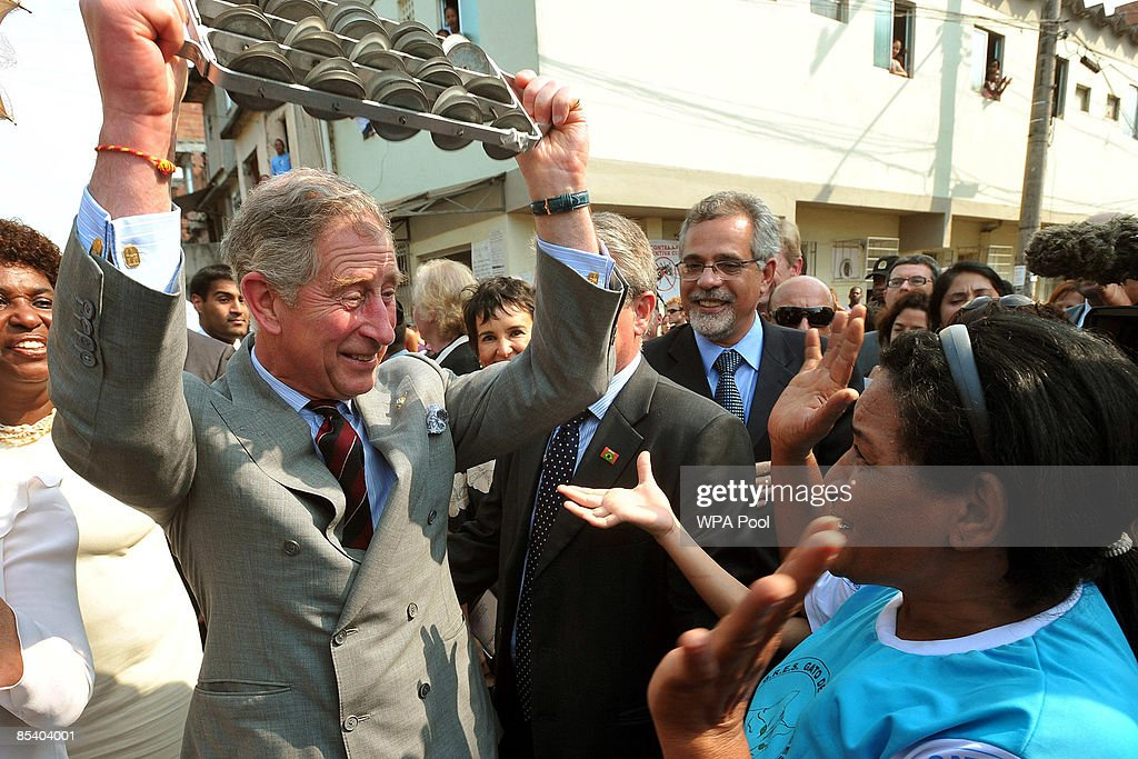 <a gi-track='captionPersonalityLinkClicked' href=/galleries/search?phrase=Prince+Charles&family=editorial&specificpeople=160180 ng-click='$event.stopPropagation()'>Prince Charles</a>, Prince of Wales and Camilla, Duchess of Cornwall join traditional Samba dancers as they perform during a tour of the Marie Complexo Favela on March 12, 2009 in Rio De Janeiro, Brazil. The Prince and the Duchess are in Brazil as part of a ten day tour of South America taking in Chile, Brazil, Ecuador and the Galapagos.