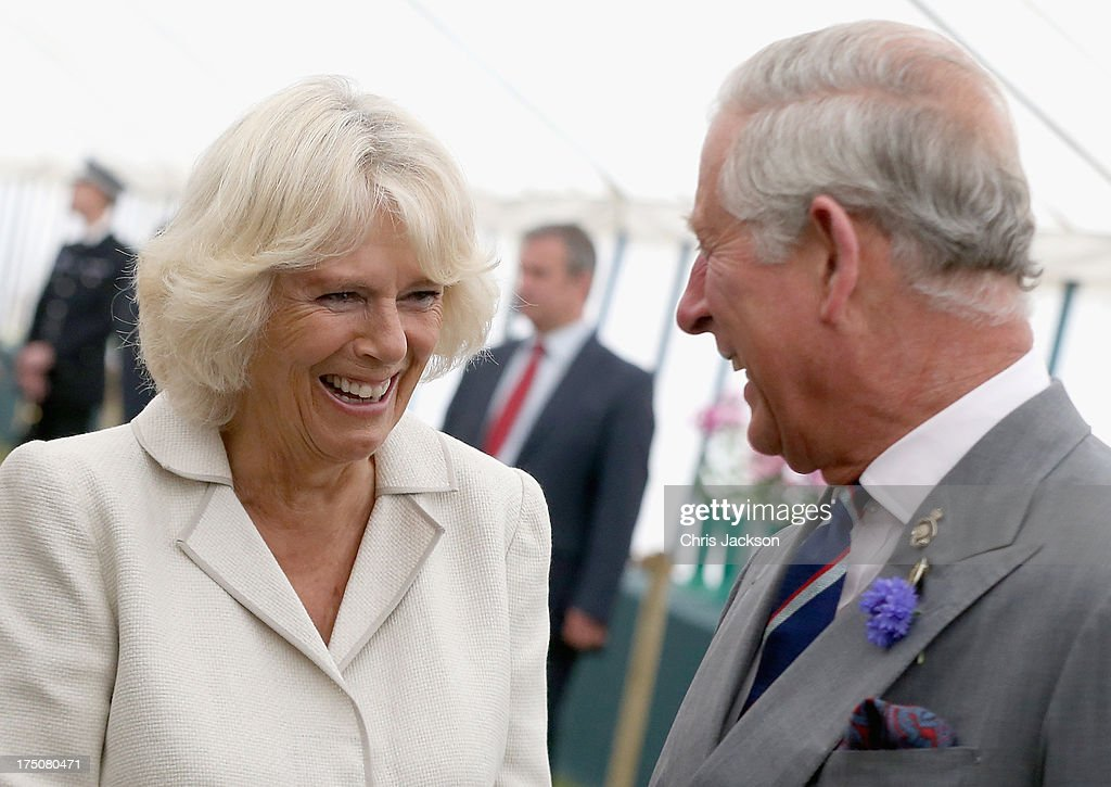 Prince Charles, Prince of Wales and <a gi-track='captionPersonalityLinkClicked' href=/galleries/search?phrase=Camilla+-+Hertogin+van+Cornwall&family=editorial&specificpeople=158157 ng-click='$event.stopPropagation()'>Camilla</a>, Duchess of Cornwall laugh during a visit to the 132nd Sandringham Flower Show at Sandringham House on July 31, 2013 in King's Lynn, England.