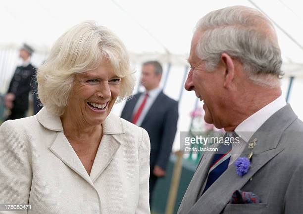 Prince Charles Prince of Wales and Camilla Duchess of Cornwall laugh during a visit to the 132nd Sandringham Flower Show at Sandringham House on July...