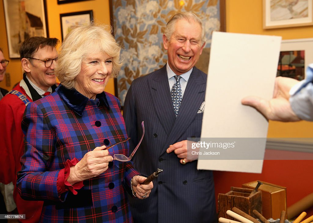 <a gi-track='captionPersonalityLinkClicked' href=/galleries/search?phrase=Prince+Charles&family=editorial&specificpeople=160180 ng-click='$event.stopPropagation()'>Prince Charles</a>, Prince of Wales and <a gi-track='captionPersonalityLinkClicked' href=/galleries/search?phrase=Camilla+-+Duchess+of+Cornwall&family=editorial&specificpeople=158157 ng-click='$event.stopPropagation()'>Camilla</a>, Duchess of Cornwall laugh at a piece of gold tool embossing the Duchess created during a visit to the Art Worker's Guild on February 5, 2015 in London, England.