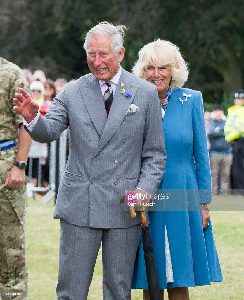 Prince Charles Prince of Wales and Camilla Duchess of Cornwall laugh after meeting an eagle called Zephyr the mascot of the Army Air Corps at...