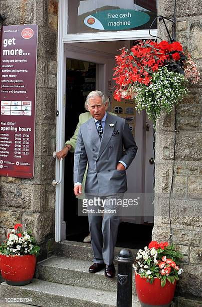 Prince Charles Prince of Wales and Camilla Duchess of Cornwall leave a post office as they visit the village of Marazion on July 12 2010 in Marazion...