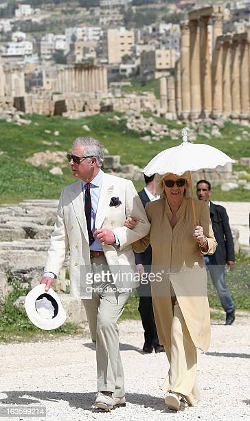 Prince Charles Prince of Wales and Camilla Duchess of Cornwall link arms as they visit the ancient Roman ruins in Jaresh on the third day of a visit...