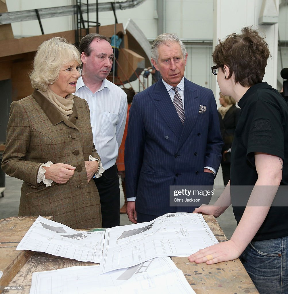 Prince Charles, Prince of Wales and Camilla, Duchess of Cornwall look at set-designs during an official visit to Essex and High House Production Park on January 29, 2014 in Purfleet, England. High House Production Park is a world-class centre for technical skills, crafts and artistic production and training, which is home to the Royal Opera House's Bob and Tamar Manoukian Production workshop, the National Skills Academys Backstage Centre and Acme High House Artists Studios.