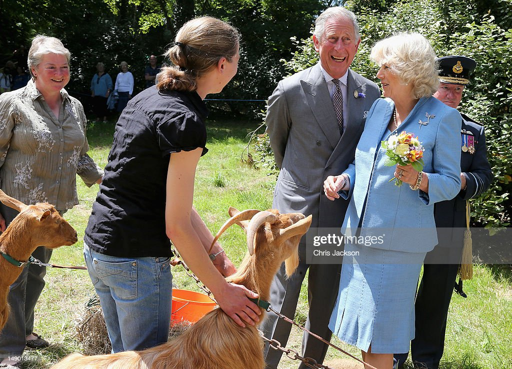 <a gi-track='captionPersonalityLinkClicked' href=/galleries/search?phrase=Prince+Charles&family=editorial&specificpeople=160180 ng-click='$event.stopPropagation()'>Prince Charles</a>, Prince of Wales and <a gi-track='captionPersonalityLinkClicked' href=/galleries/search?phrase=Camilla+-+Duchess+of+Cornwall&family=editorial&specificpeople=158157 ng-click='$event.stopPropagation()'>Camilla</a>, Duchess of Cornwall meet a goat as they visit Saumarez Park on July 19, 2012 in St Peter's Port, United Kingdom. The Prince of Wales and the Duchess of Cornwall are in Guernsey as part of a Diamond Jubilee visit to the Channel Islands taking in Jersey, Guernsey and Sark