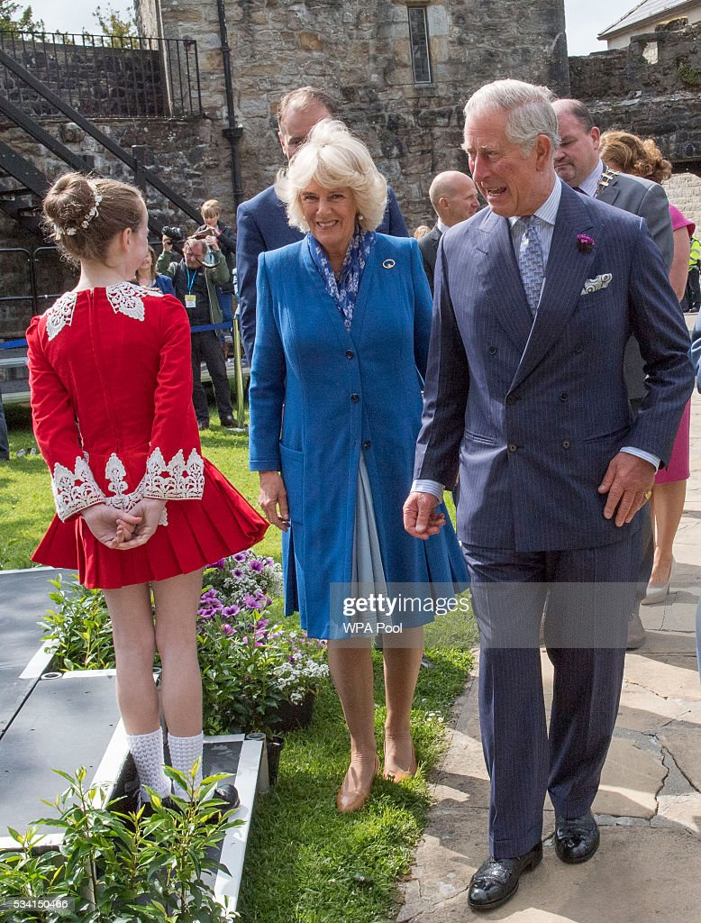 <a gi-track='captionPersonalityLinkClicked' href=/galleries/search?phrase=Prince+Charles&family=editorial&specificpeople=160180 ng-click='$event.stopPropagation()'>Prince Charles</a>, Prince of Wales and <a gi-track='captionPersonalityLinkClicked' href=/galleries/search?phrase=Camilla+-+Duchess+of+Cornwall&family=editorial&specificpeople=158157 ng-click='$event.stopPropagation()'>Camilla</a>, Duchess of Cornwall meet a young Irish dancer as they visit Donegal Castle on May 25, 2016 in Letterkenny, Ireland. The royal couple are on a one day visit to Ireland having spent two days across the border in Northern Ireland. It is their first trip to Donegal.