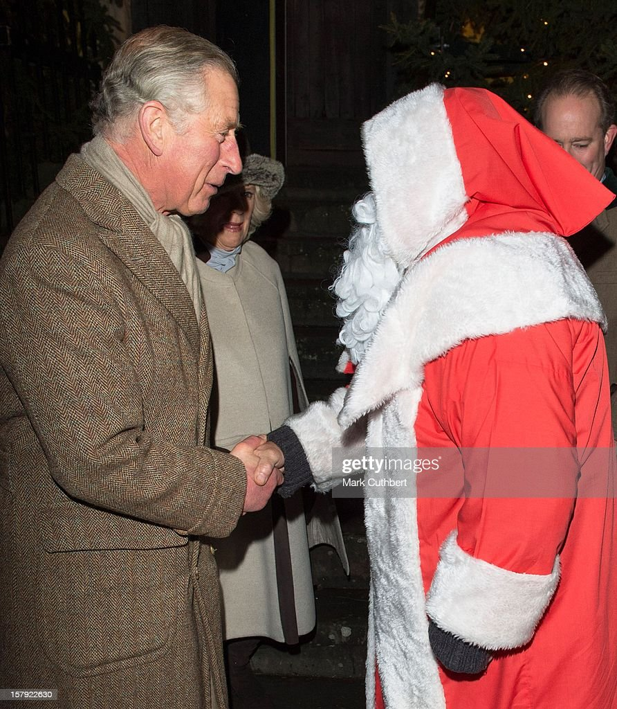 <a gi-track='captionPersonalityLinkClicked' href=/galleries/search?phrase=Prince+Charles+-+Prince+of+Wales&family=editorial&specificpeople=160180 ng-click='$event.stopPropagation()'>Prince Charles</a>, Prince of Wales and <a gi-track='captionPersonalityLinkClicked' href=/galleries/search?phrase=Camilla+-+Duchess+of+Cornwall&family=editorial&specificpeople=158157 ng-click='$event.stopPropagation()'>Camilla</a>, Duchess of Cornwall meet Father Christmas as they switch on the Christmas lights on December 7, 2012 in Tetbury, England.