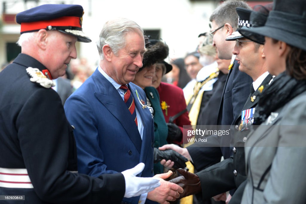 Prince Charles, Prince of Wales and Camilla, Duchess of Cornwall meet dignitaries at St John The Baptist City Parish Church as they attend the National St David's Day service on March 1, 2013 in Cardiff, Wales.