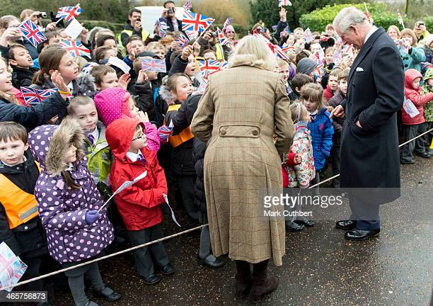 Prince Charles Prince of Wales and Camilla Duchess of Cornwall meet local school children during a visit to 'The Bell' Pub during an official visit...