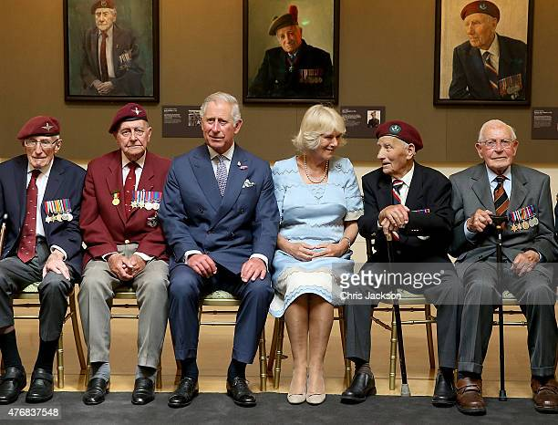 Prince Charles Prince of Wales and Camilla Duchess of Cornwall meet veterans on a visit to a DDay Veterans portrait exhibition 'The Last Of The Tide'...