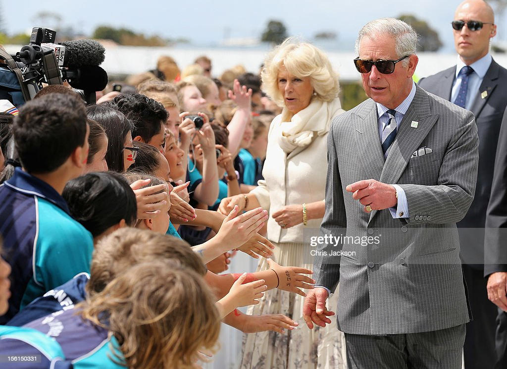 <a gi-track='captionPersonalityLinkClicked' href=/galleries/search?phrase=Prince+Charles&family=editorial&specificpeople=160180 ng-click='$event.stopPropagation()'>Prince Charles</a>, Prince of Wales and <a gi-track='captionPersonalityLinkClicked' href=/galleries/search?phrase=Camilla+-+Duchess+of+Cornwall&family=editorial&specificpeople=158157 ng-click='$event.stopPropagation()'>Camilla</a>, Duchess of Cornwall meets children during a visit to AUT Millennium on November 12, 2012 in Auckland, New Zealand. The Royal couple are in New Zealand on the last leg of a Diamond Jubilee that takes in Papua New Guinea, Australia and New Zealand.