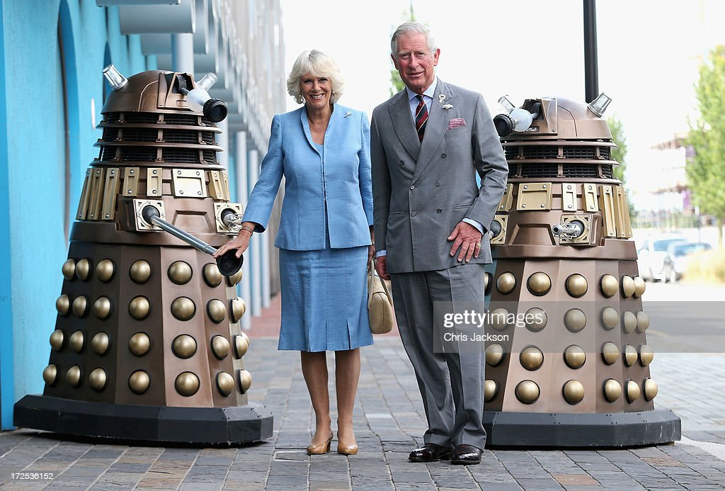 Prince Charles, Prince of Wales and Camilla, Duchess of Cornwall pose next to two Daleks as they visit BBC Roath Lock Studios on July 3, 2013 in Cardiff, Wales.
