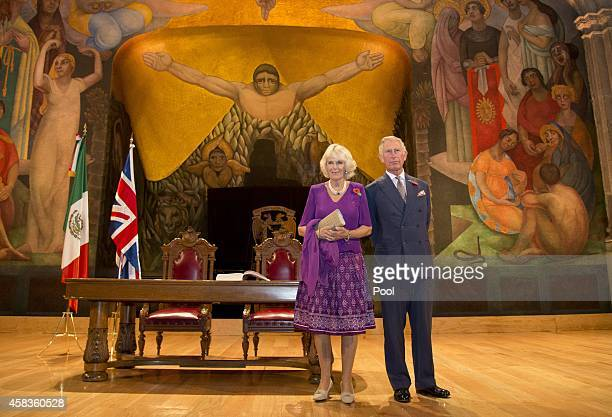 Prince Charles Prince of Wales and Camilla Duchess of Cornwall pose in front of a Diego Rivera mural after signing the visitor's book at the launch...