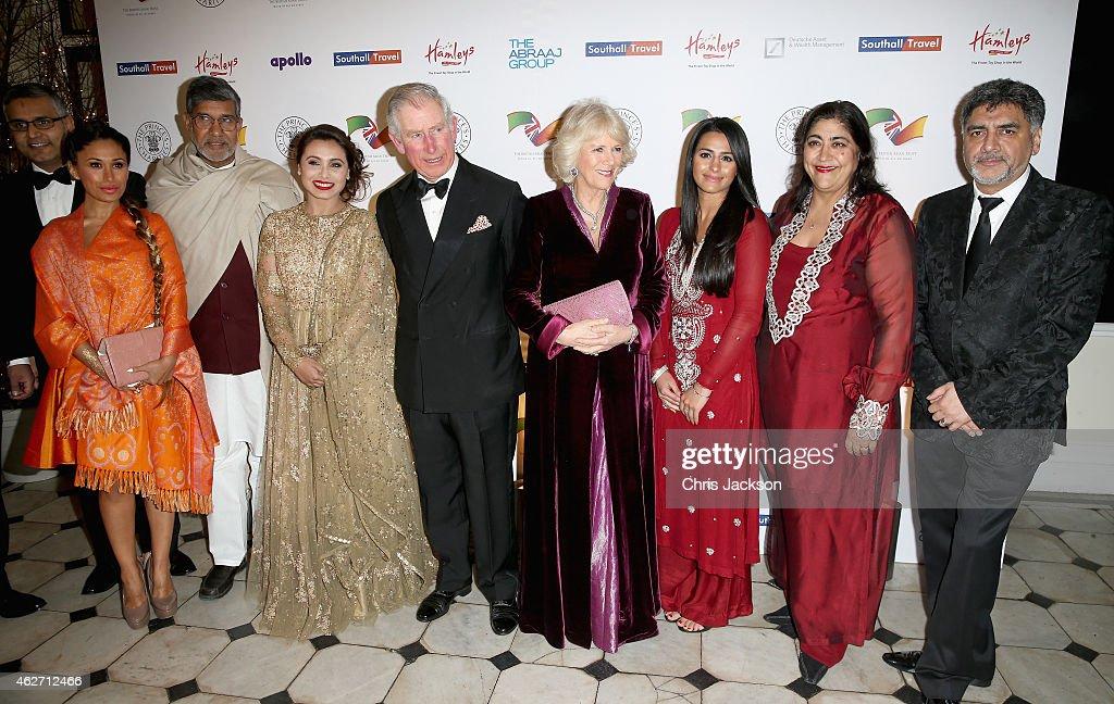 Prince Charles, Prince of Wales and Camilla, Duchess of Cornwall pose with (L-R) Preeya Kalidas, Kailash Satyarthi, actress Rani Mukerji, Sair Khan, Gurinder Chadha and James Caan as they attend the British Asian Trust dinner at Banqueting House on February 3, 2015 in London, England.