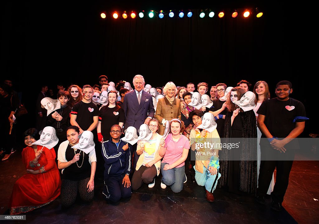Prince Charles, Prince of Wales and Camilla, Duchess of Cornwall pose for a photo with pupils taking part in the Shakespeare Schools Festival during a visit to the Palace Theatre on January 29, 2014, in Westcliff-on-Sea, Essex.