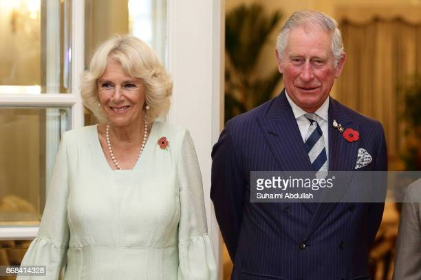 Prince Charles Prince of Wales and Camilla Duchess of Cornwall poses for a photo at the Istana on October 31 2017 in Singapore Their Royal Highnesses...