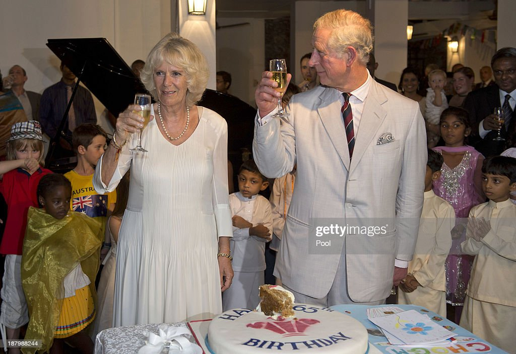 <a gi-track='captionPersonalityLinkClicked' href=/galleries/search?phrase=Prince+Charles&family=editorial&specificpeople=160180 ng-click='$event.stopPropagation()'>Prince Charles</a>, Prince of Wales and <a gi-track='captionPersonalityLinkClicked' href=/galleries/search?phrase=Camilla+-+Duchess+of+Cornwall&family=editorial&specificpeople=158157 ng-click='$event.stopPropagation()'>Camilla</a>, Duchess of Cornwall raise their glasses after cutting his 65th Birthday cake during a reception at the British High Commission on November 14, 2013 in Colombo, Sri Lanka. The Royal couple are visiting Sri Lanka in order to attend the 2013 Commonwealth Heads of Government Meeting.