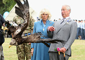 Prince Charles Prince of Wales and Camilla Duchess of Cornwall react as Zephyr the mascot of the Army Air Corps flaps his wings at Sandringham Flower...