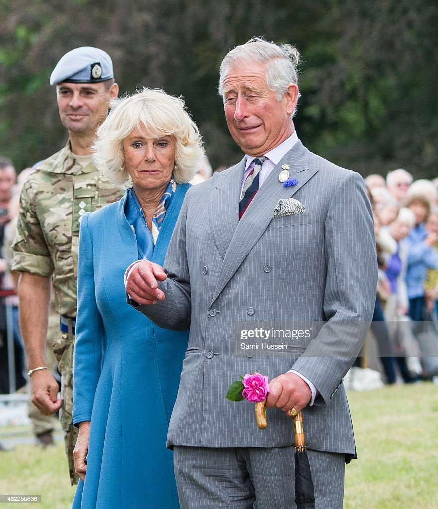 Prince Charles Prince of Wales and Camilla Duchess of Cornwall react as an eagle called Zephyr the mascot of the Army Air Corps flaps his wings at...