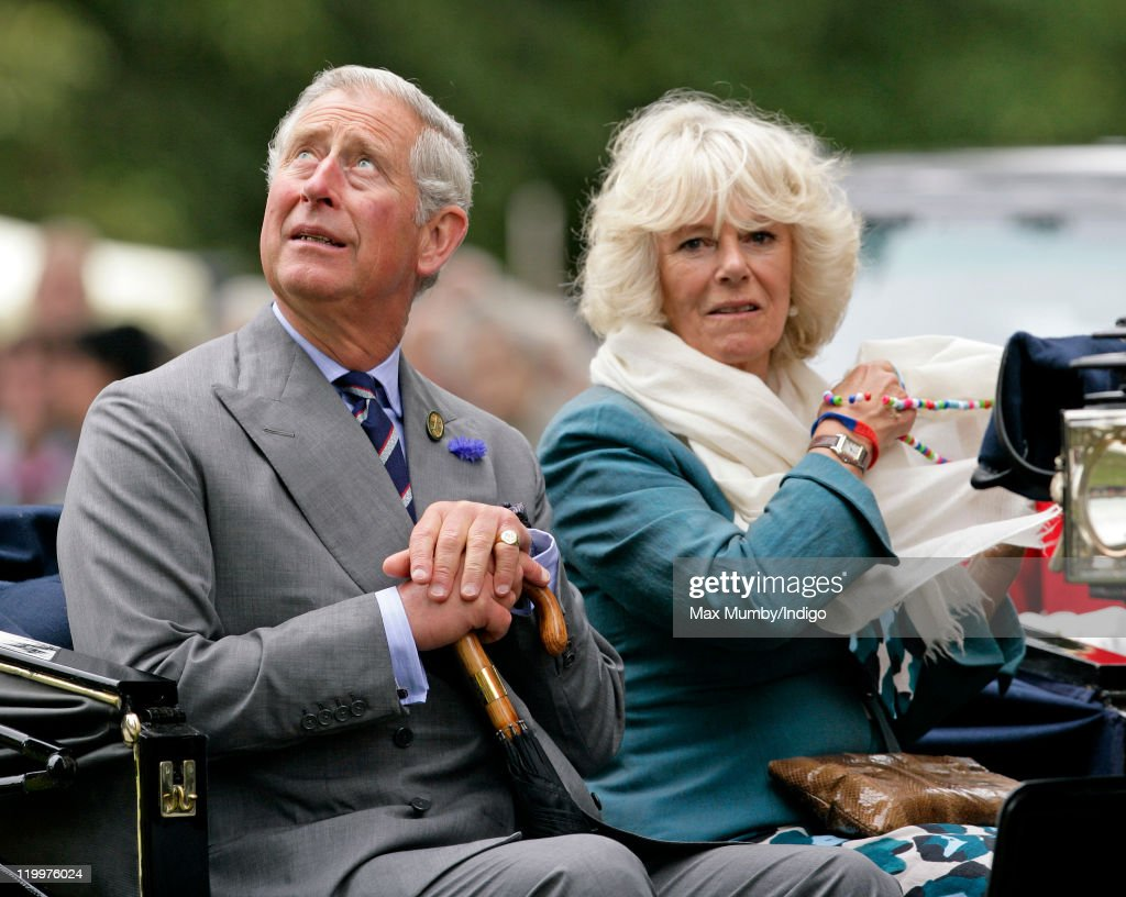 Prince Charles, Prince of Wales and Camilla, Duchess of Cornwall ride in a horse drawn carriage as they visit the 130th Sandringham Flower Show on July 27, 2011 in Huntingdon, England.