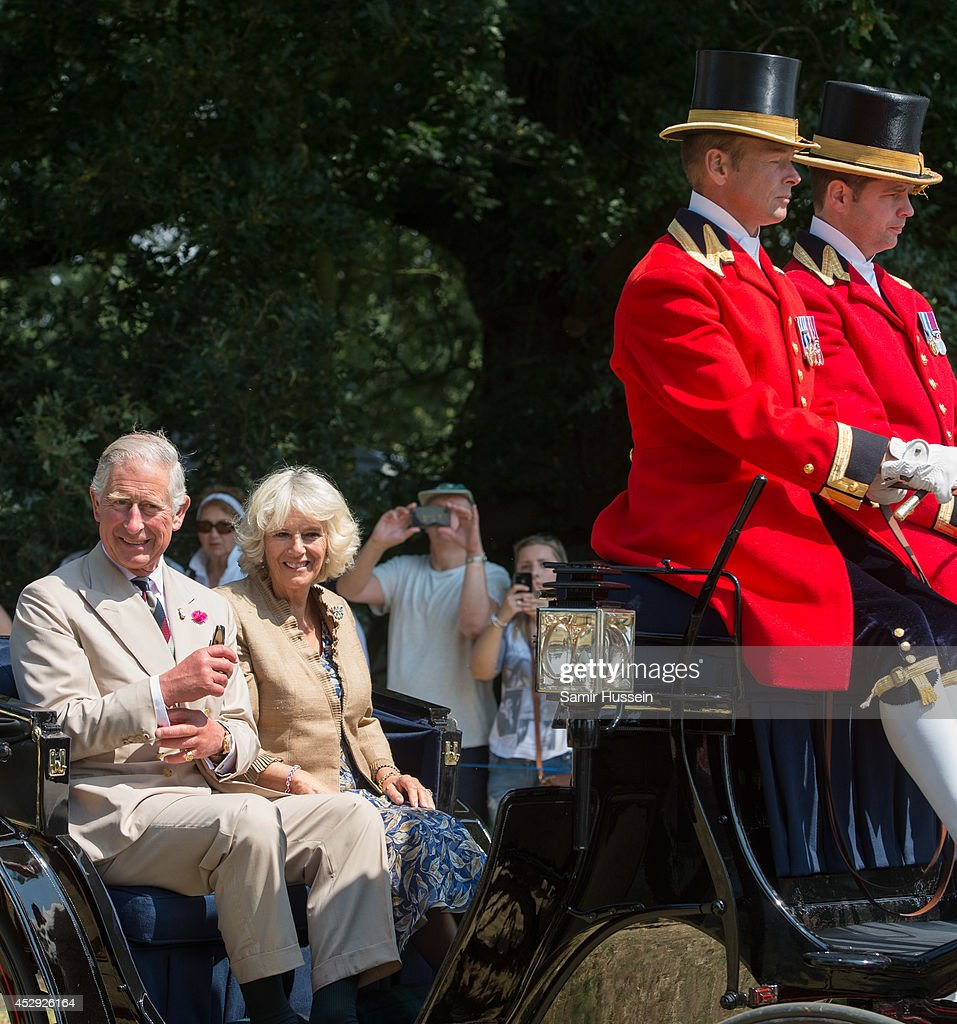 Prince Charles Prince of Wales and Camilla Duchess of Cornwall ride in a carriage at Sandringham Flower Show on July 30 2014 in Sandringham England