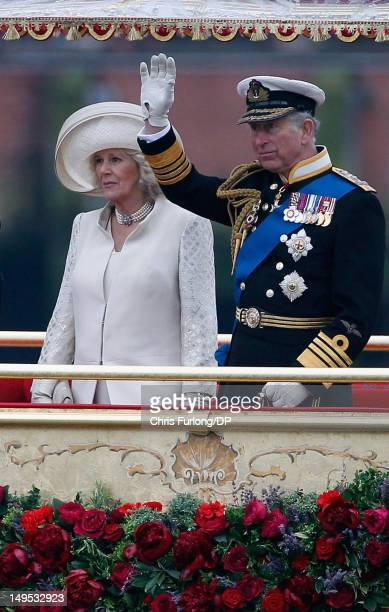 Prince Charles Prince of Wales and Camilla Duchess of Cornwall sail on the royal barge 'The Spirit of Chartwell' during the Thames Diamond Jubilee...