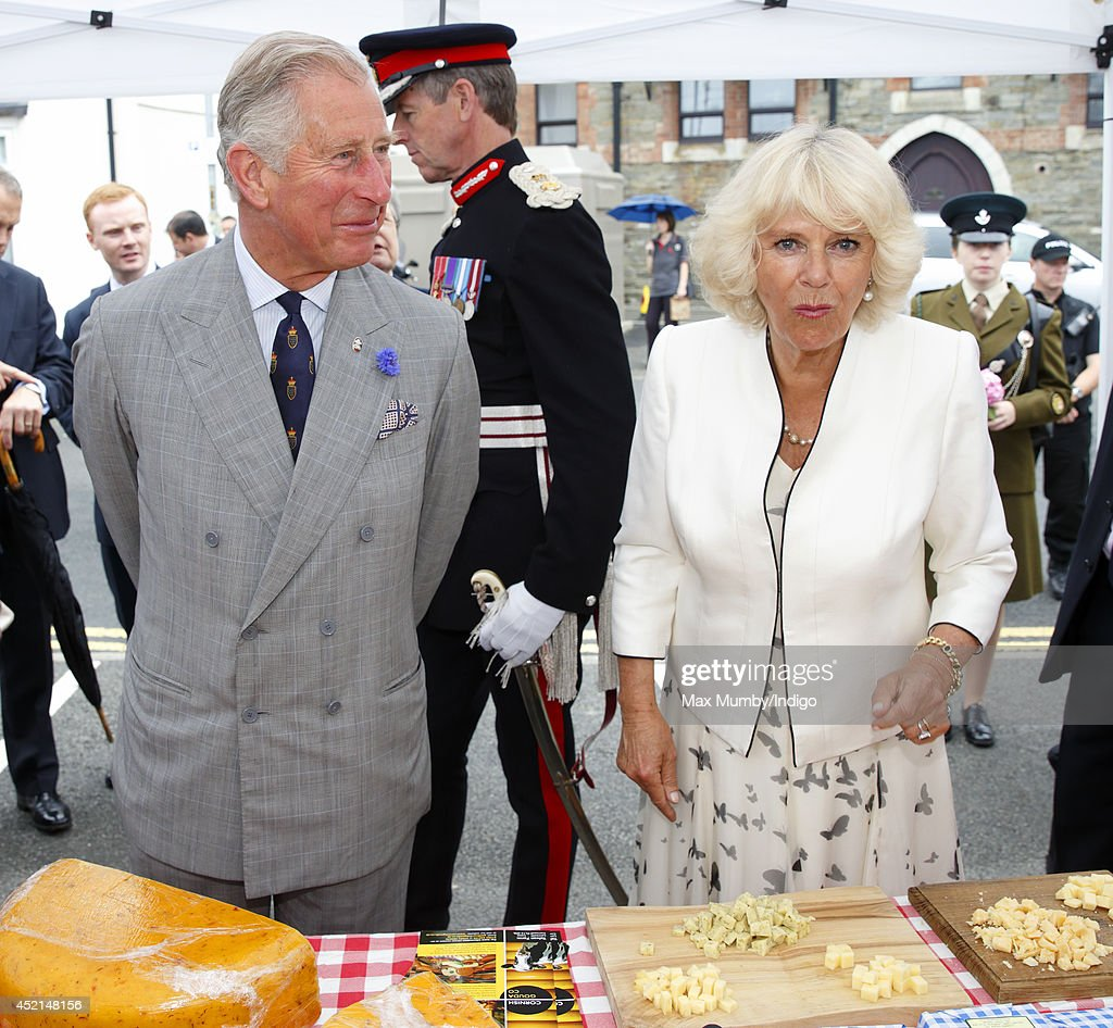 <a gi-track='captionPersonalityLinkClicked' href=/galleries/search?phrase=Prince+Charles+-+Prince+of+Wales&family=editorial&specificpeople=160180 ng-click='$event.stopPropagation()'>Prince Charles</a>, Prince of Wales and <a gi-track='captionPersonalityLinkClicked' href=/galleries/search?phrase=Camilla+-+Duchess+of+Cornwall&family=editorial&specificpeople=158157 ng-click='$event.stopPropagation()'>Camilla</a>, Duchess of Cornwall sample some cheese as they tour a market on day one of the annual visit to Devon and Cornwall on July 14, 2014 in Looe, England.