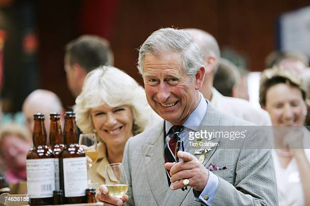 Prince Charles Prince of Wales and Camilla Duchess of Cornwall sample locally produced cider during a visit to the Three Counties Show in its 50th...