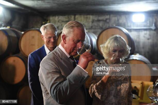 Prince Charles Prince of Wales and Camilla Duchess of Cornwall sample mulled wine during a visit to Norman Hardie Winery during day two of their...
