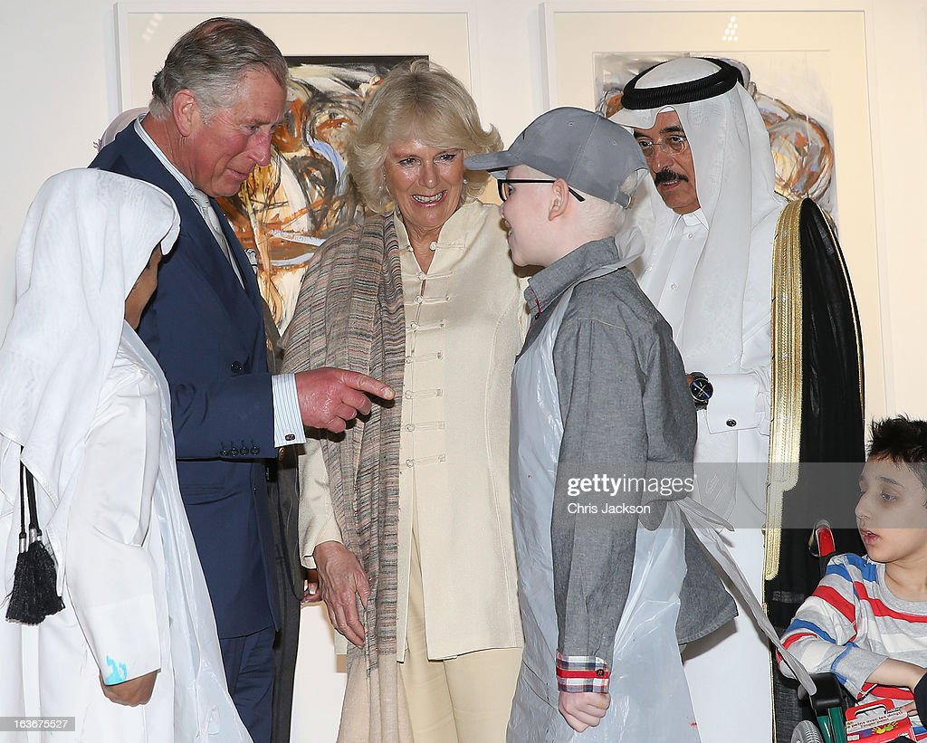 <a gi-track='captionPersonalityLinkClicked' href=/galleries/search?phrase=Prince+Charles&family=editorial&specificpeople=160180 ng-click='$event.stopPropagation()'>Prince Charles</a>, Prince of Wales and <a gi-track='captionPersonalityLinkClicked' href=/galleries/search?phrase=Camilla+-+Duchess+of+Cornwall&family=editorial&specificpeople=158157 ng-click='$event.stopPropagation()'>Camilla</a>, Duchess of Cornwall share a joke with children at an art project in the Katara Cultural Village on the fourth day of a tour of the Middle East on March 14, 2013 in Doha, Qatar. The Royal couple are on the second leg of a tour of the Middle East taking in Qatar, Saudia Arabia and Oman.