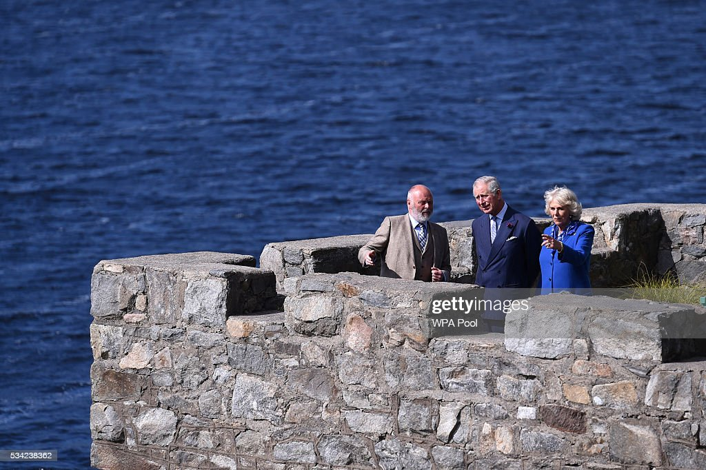 <a gi-track='captionPersonalityLinkClicked' href=/galleries/search?phrase=Prince+Charles&family=editorial&specificpeople=160180 ng-click='$event.stopPropagation()'>Prince Charles</a>, Prince of Wales and <a gi-track='captionPersonalityLinkClicked' href=/galleries/search?phrase=Camilla+-+Duchess+of+Cornwall&family=editorial&specificpeople=158157 ng-click='$event.stopPropagation()'>Camilla</a>, Duchess of Cornwall take in the surroundings from the boathouse roof with their guide Mr Dave Duggan, Divisional Manager Parks and Wildlife Service (L) as they visited Glenveagh Castle on May 25, 2016 in Letterkenny, Ireland. The royal couple are on a one day visit to Ireland having spent two days across the border in Northern Ireland. It is their first trip to Donegal.